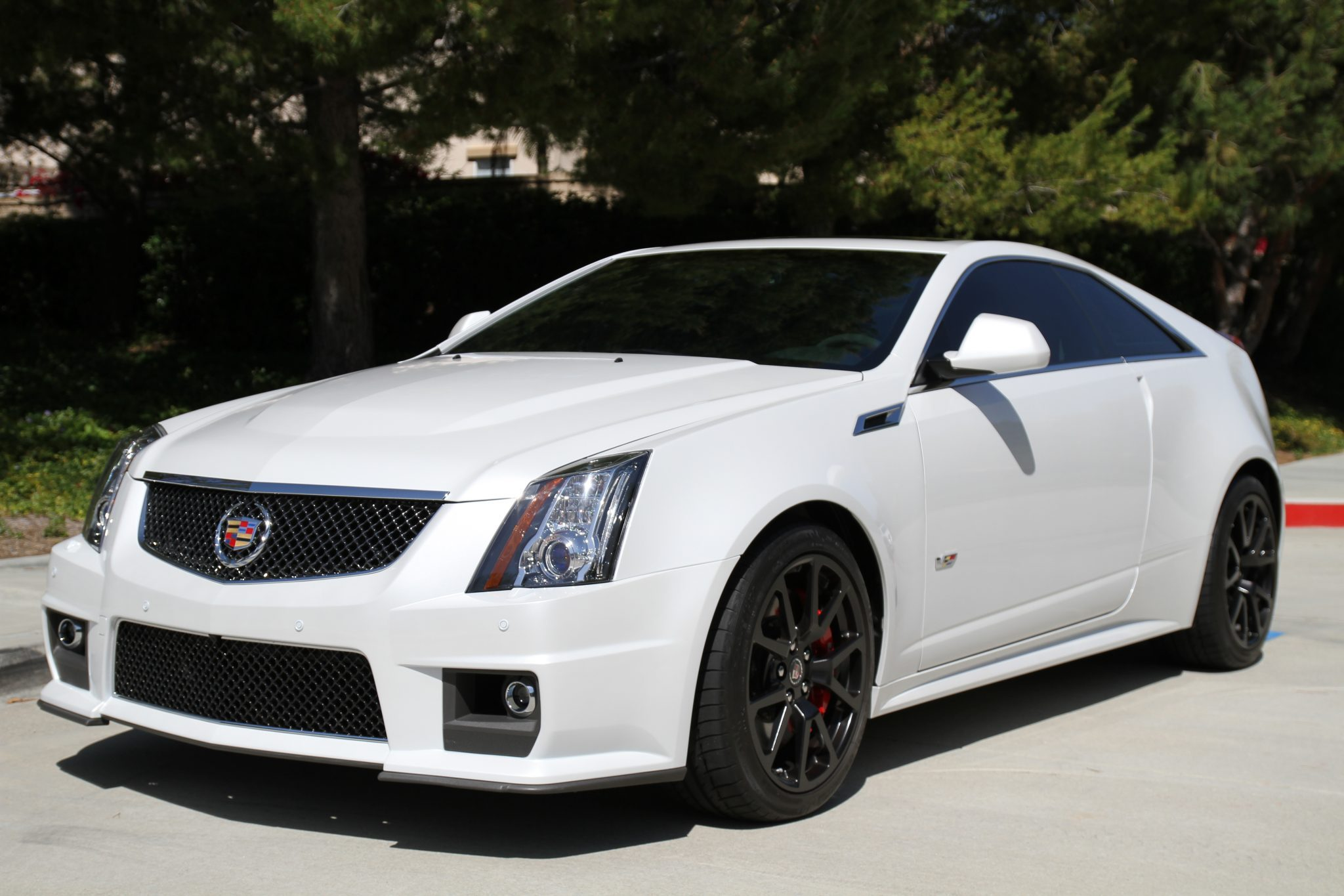2011-cadillac-cts-v-coupe-crystal-white-tricoat-1.jpg