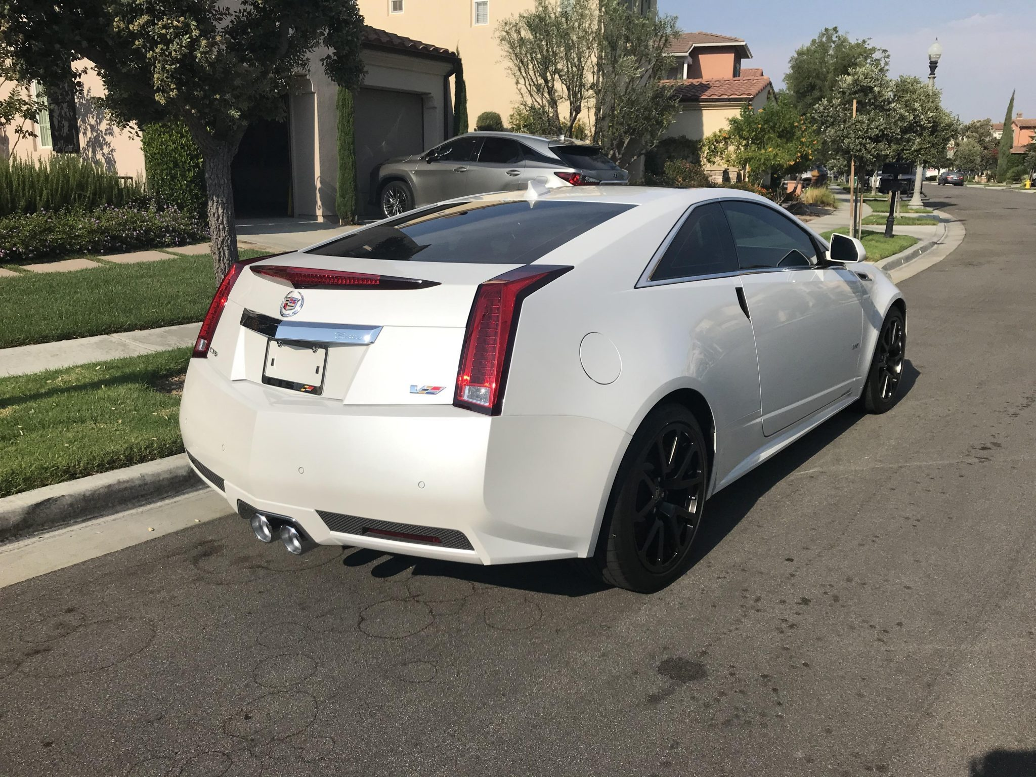 2011-cadillac-cts-v-coupe-crystal-white-tricoat-3.jpg