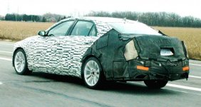 2014-Cadillac-CTS-driving-rear-3-4.jpg