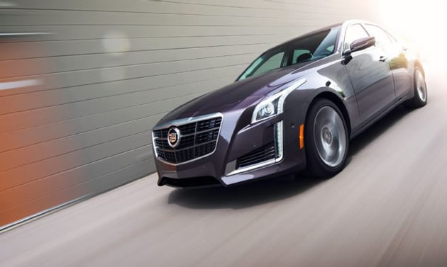 2014-cadillac-cts-vsport-motion-front-three-quarter-1