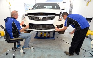 One of the reasons an Xpel installation, such as what we did with our ATS-V, takes so long is the time consuming nature of applying large sections of film, getting it positioned properly, then making sure any air between the film and the exterior surface of the car is removed. Image: Author.